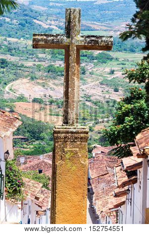 Stone Cross And Colonial Town