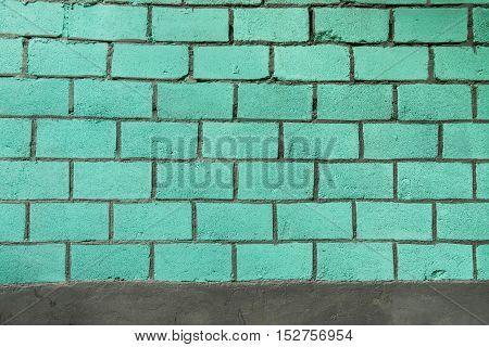 weathered ultramarine brick wall. Vintage texture background.