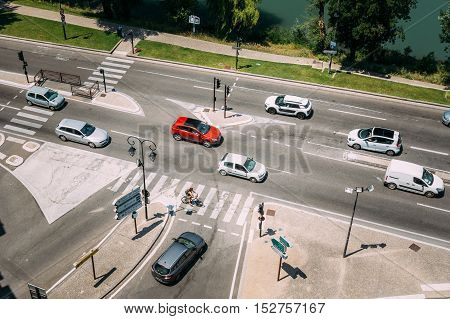 Movement of cars during sunny summer day on the boulevard de la Ligne in Avignon, France. View of the street from the castle walls.