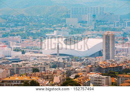 Cityscape of Marseille, France. Urban background with sport Velodrome stadium. Stade Velodrome.