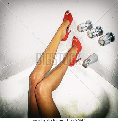 Gritty Snapshot Style Image Of Slender Woman's Legs In High Heel Shoes Passed Out Drunk In A Motel B