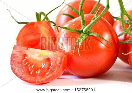 close up from tomatoes on white background