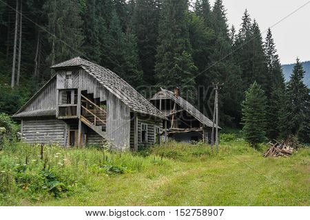 Old wooden house in the mountains near the forest