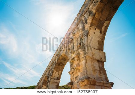 Part, detail of famous landmark ancient old Roman aqueduct of Pont du Gard, Nimes, France