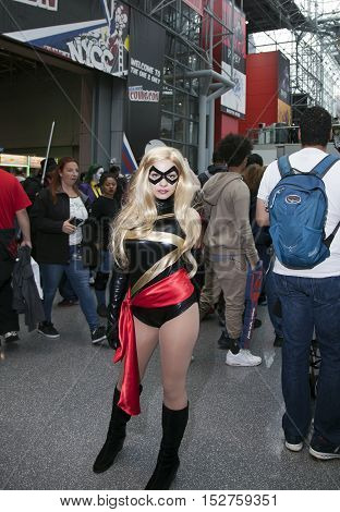 NEW YORK NEW YORK - OCTOBER 9: Woman wearing Ms. Marvel costume at NY Comic Con at Jacob K. Javits convention center. Taken October 9 2016 in New York.