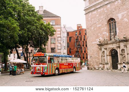 Riga, Latvia - July 1, 2016: The Colorful Striped Touristic Bus In The Historic Center Of Old Town, Going To Start For Panorama City Sightseeing Tour.