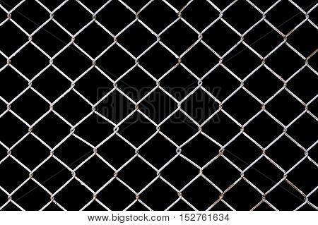 Rusty Chain Link Fence on black background, Black and white abstract closeup of a chain link background
