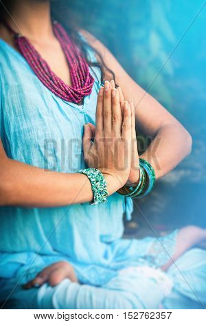 closeup of woman hands  in meditative pose practice yoga outdoor shot