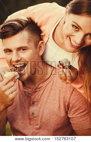 Lovely Couple Eating Cupcakes.