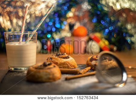 biscuits with glass of milk on shiny background