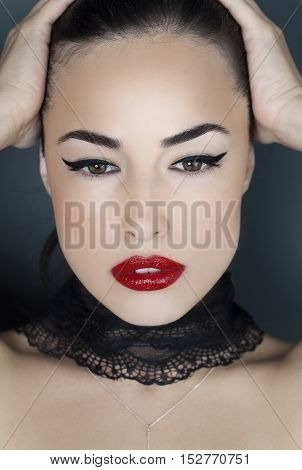 woman portrait with red lips and black eyeliner beauty closeup