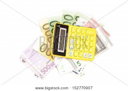 Calculator with euro bank notes isolated on white