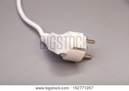White plug isolated on a gray background