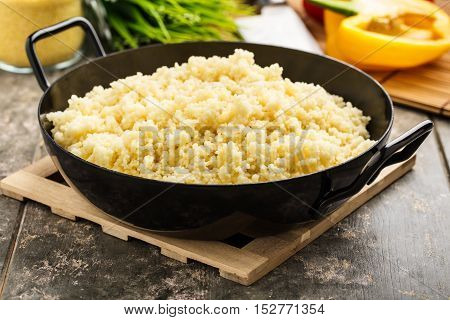 fresh cooked couscous served in a pan.