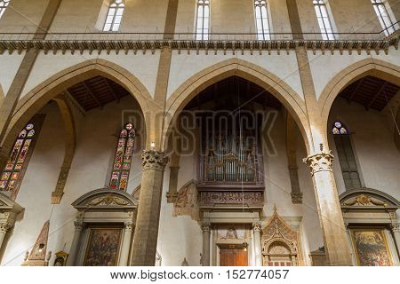 FLORENCE, ITALY - SEPTEMBER 2016 : Pipe organ, musical instrument, at Basilica of the Holy Cross, Franciscan church in Florence, Italy on September 21, 2016. Known as temple of the Italian Glories
