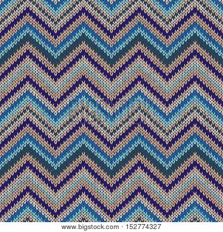 Seamless geometric ethnic spokes knitted pattern. Blue white orange beige color knitwear sample