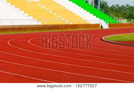 athletics stadium with red track : sport theme