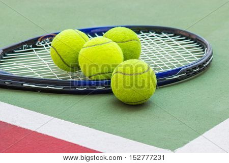 Tennis Ball with Racket on the clay tennis court