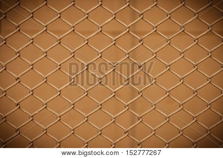 chain fence metallic net with brown background