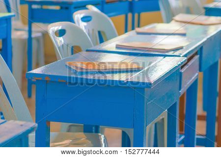 book in blue desk classroom in thailand