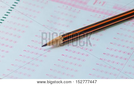 pencil on answer sheet test score sheet with answers in thai education