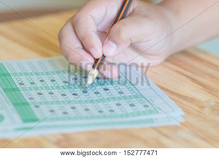 student testing in exercise exams answer sheets on table education
