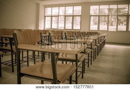 Chair in empty classroom lecture armchairs in school or college