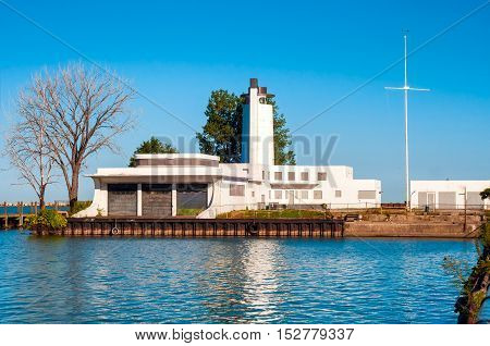 CLEVELAND OH - SEPTEMBER 14 2015: The old coast guard station sits abandoned on Cleveland's lakeshore waiting to be repurposed and renovated by the Metroparks division. It is a popular hangout spot.