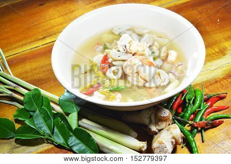 seafood spicy hot soup and mixed herb
