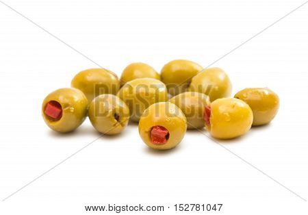 Green olives stuffed with red paprika isolated on white