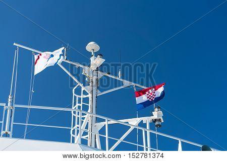 Zadar, Croatia - July 20, 2016: the flag of Croatia and Jadrolinija company at the ferry boat. Car ferry boats linking the islands to mainland