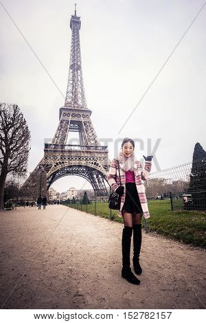 Beautiful woman with the Eiffel tower in Paris, France