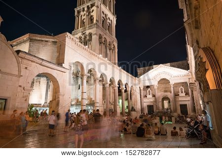 Split, Croatia - July 20, 2016: a lot of people at the peristyle in the Diocletian Palace at night