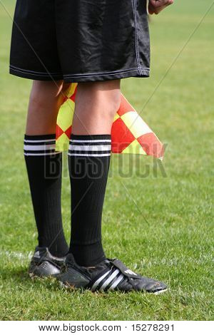 Soccer linesman legs