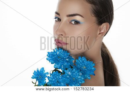 young woman beauty portrait with blue flowers, studio white