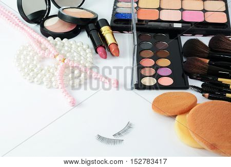 makeup brush,lipstick,eysshodows and cosmetics on white background.