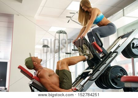 At gym. Young people having fun during training on simulator