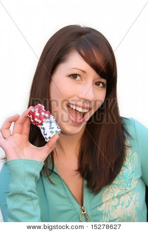 Beautiful young woman holding a stack of poker chips, isolated against a white background