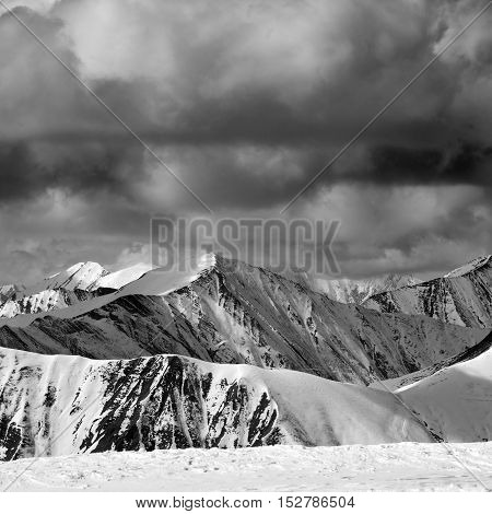 Black And White Winter Snow Mountains In Dark Storm Clouds