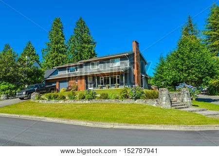 North american family house with landscaping and blue sky background. Canada