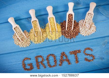 Inscription Groats And Spoons With Various Groats, Healthy Food And Nutrition