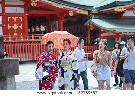 Kyoto,Japan-June 26,Two women's kimonos enjoy to respect belief by beautiful mind within Fushimi Inari shrine on June 26,2016 in Kyoto,Japan. Selective focus at wowen.