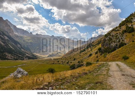 Gravel road through a beautiful valley in the Pyrenees moutnain