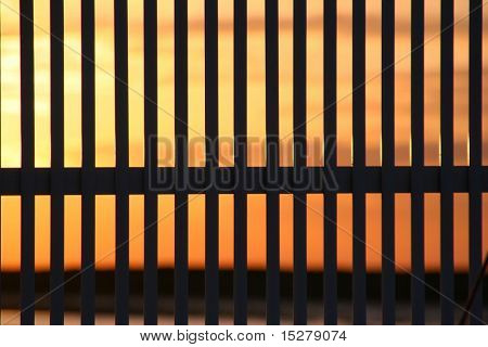 sunset behind a fence