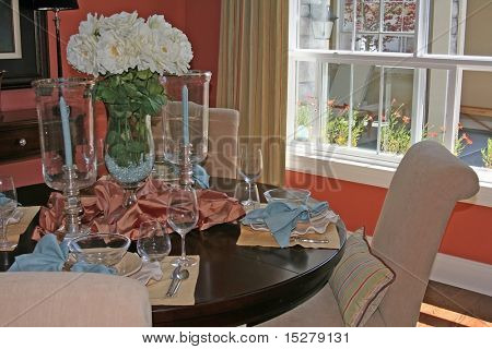 Romantic dining room with table set.