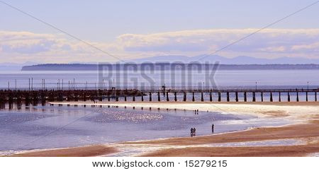 Summer beach and pier scene, Canada.