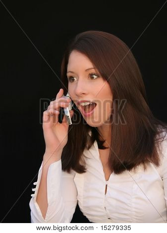 Beautiful girl on the phone, surprised.