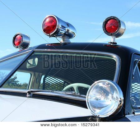 Vintage police car sirens.