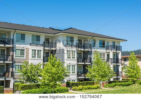 Brand new apartment building on sunny day in British Columbia Canada.