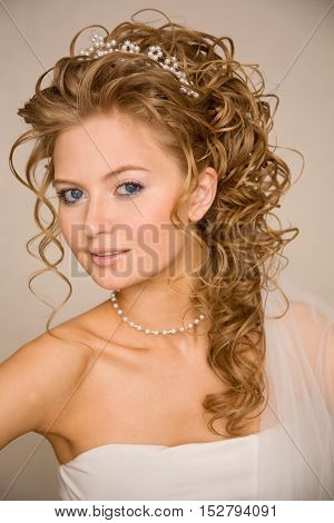 Beautiful stylish smiling bride iwith modern hairstyle